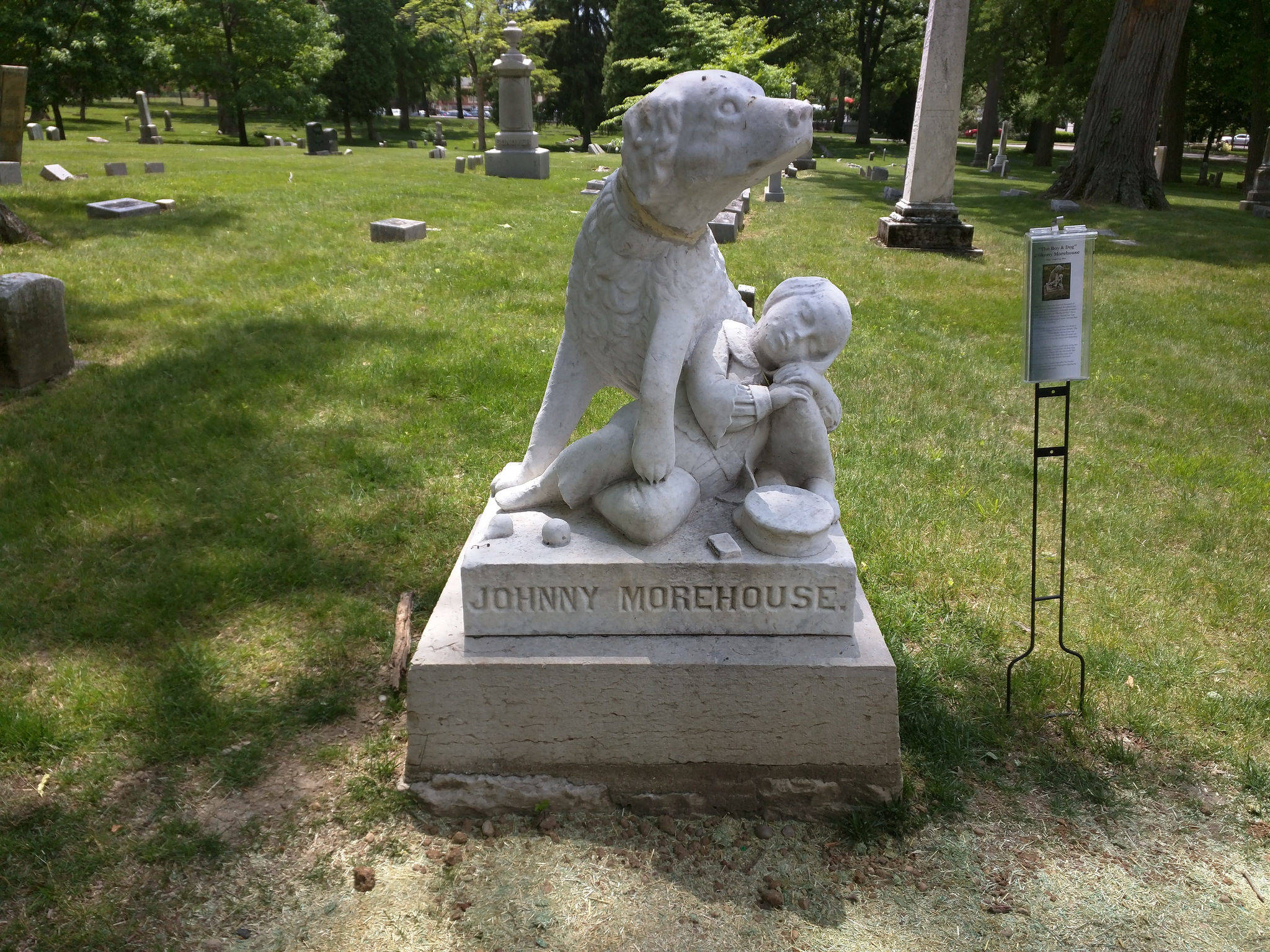 carved dog on headstone