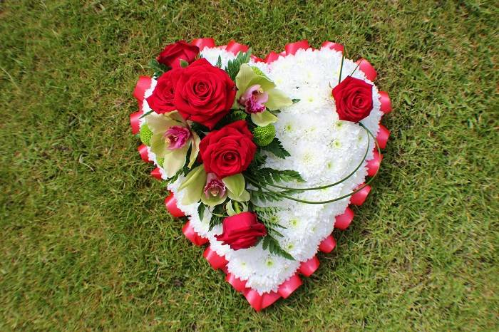 Heart-shaped floral funeral display