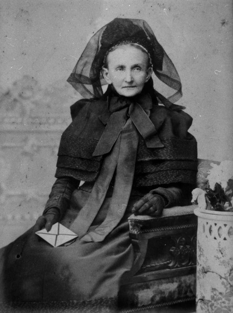 Woman in full mourning attire
