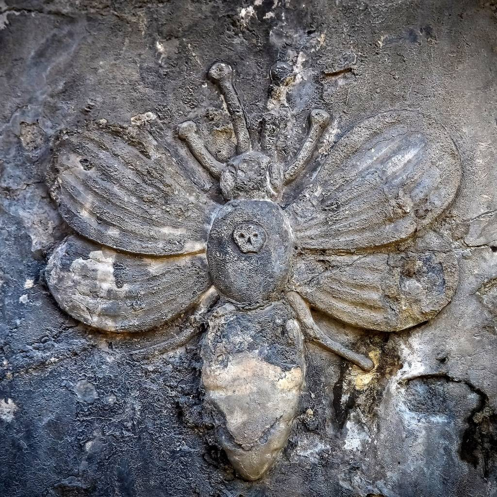 carved bee on headstone