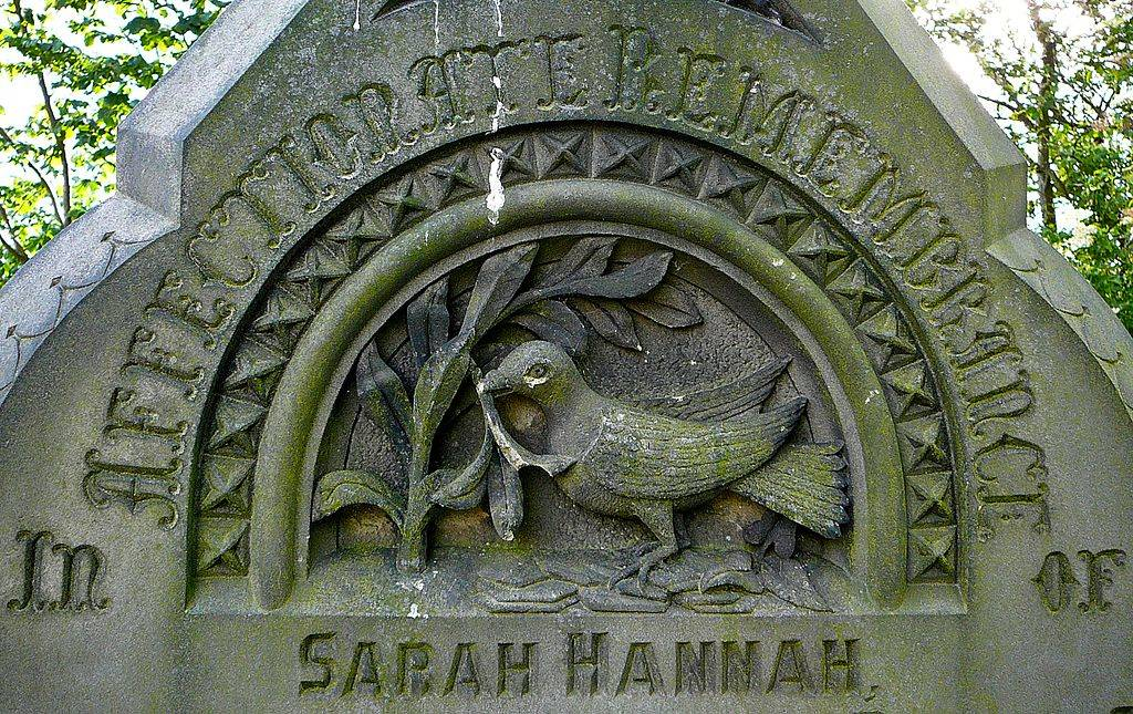 carved bird on headstone