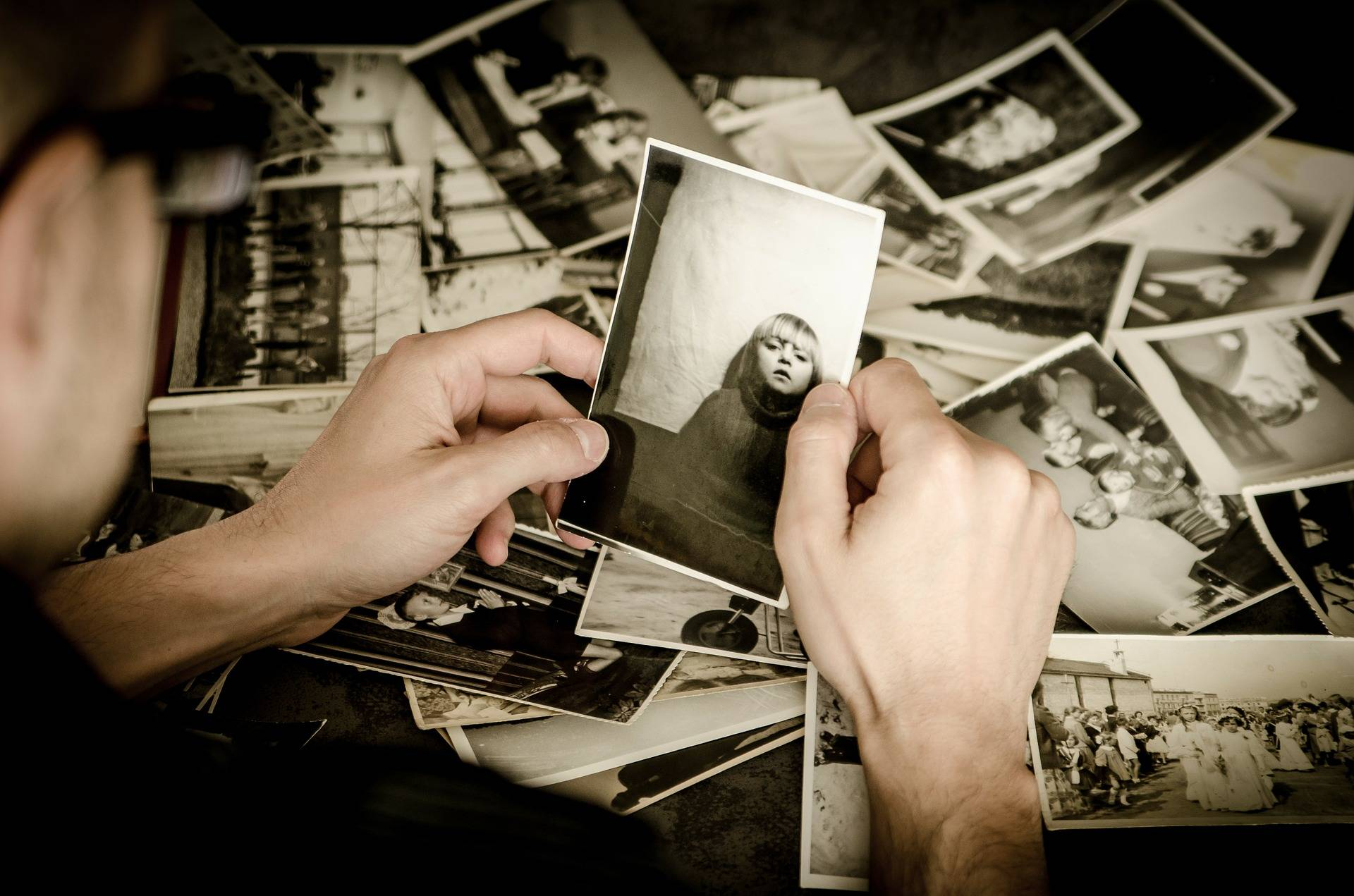 Person looking at black and white photographs