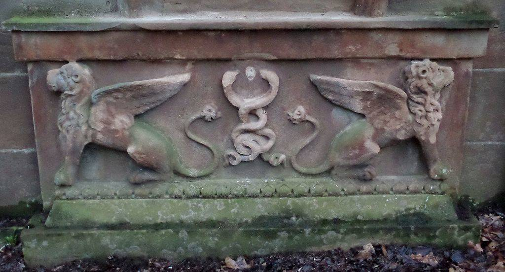 carved winged lions on headstone