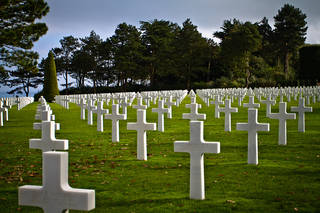 Frenchman tends ww2 Normandy Grave