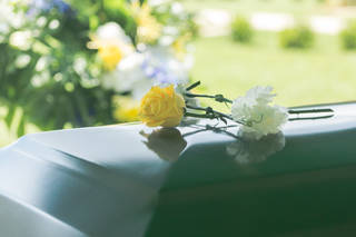Coffin with flower on top