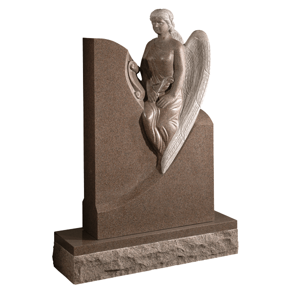 Carved Angel Sitting On Headstone